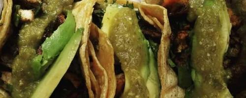 Skirt steak and chicken tacos with cilantro & avocado
